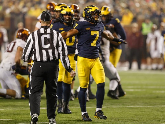 Michigan's Khaleke Hudson celebrates after making a