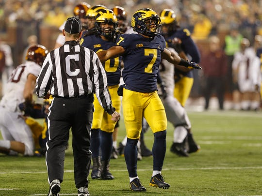 Michigan's Khaleke Hudson celebrates after making a tackle in the first half against Minnesota at Michigan Stadium in Ann Arbor on Nov. 4, 2017.