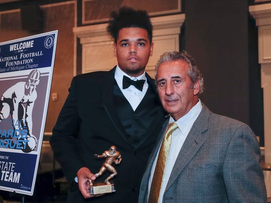 Detroit Free Press 2017 All-State Dream Team member Antwan Reed of Muskegon poses for a photo with N.F.F. State of Michigan Chapter president Tony Versaci during the National Football Foundation State of Michigan Chapter awards banquet at the Dearborn Inn in Dearborn on Dec. 10, 2017.