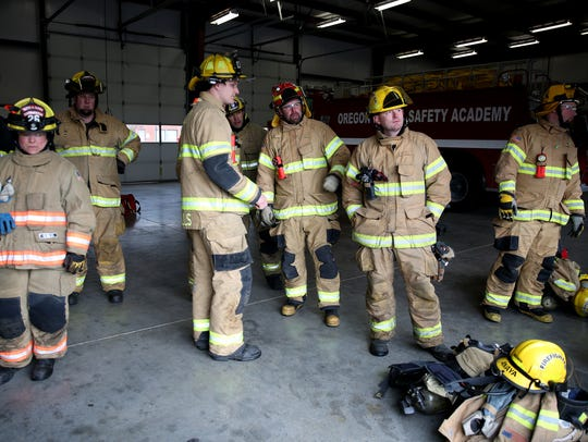 Firefighters wait for their training scenario to be