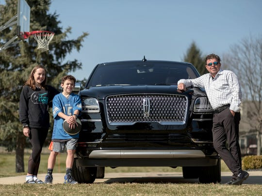 Joey Maruskin with his children Angelina and Joseph Maruskin and the 2018 Lincoln Navigator L Black Label SUV at their home in Highland Township on Wednesday, February 28, 2018.