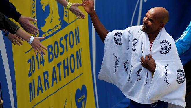 In a file photo from April 21, 2014, Meb Keflezighi (USA) greets spectators after winning the Boston Marathon.