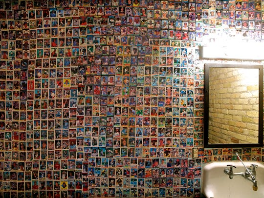 Thousands of vintage baseball cards cover the the wall