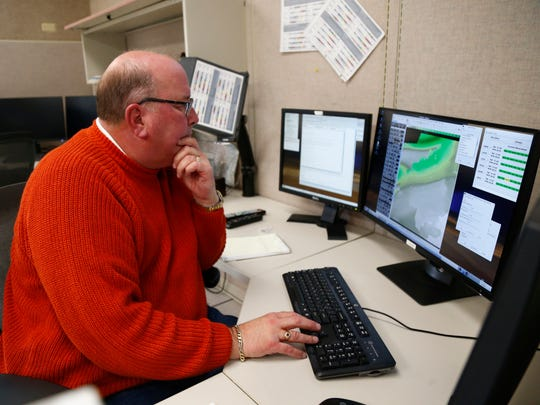 David Morford, senior forecaster for the National Weather Service looks at a weather map at the National Weather Service Binghamton Weather Forecast Office on Thursday, December 7, 2017.