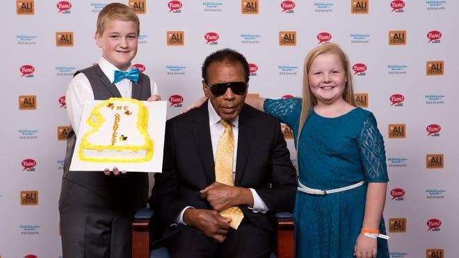 Gabe Feinn, from left, Muhammad Ali and Livvy Feinn at the Muhammad Ali Humanitarian Awards Sept. 27.
