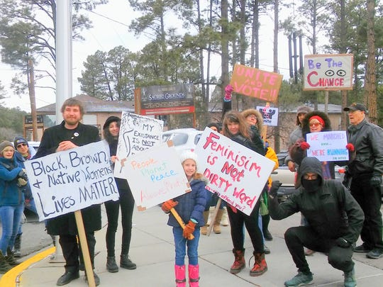 Marchers were not large in number, but showed their dedication by turning out in chilly Ruidoso weather.