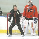 Flyers goaltending coach Kim Dillabaugh works with goalie Anthony Stolarz during the Flyers' development camp held at the Flyers Skate Zone in Voorhees on Tuesday. 07.07.15