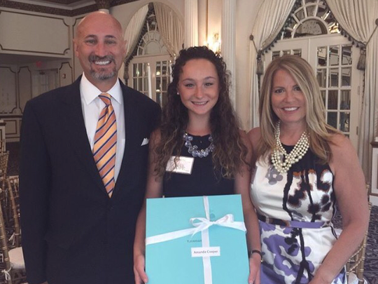 Amanda Cooper (center) is shown with her parents Scott and Karen after being honored as a 2015 Garden State Seeds of Hope Awards member.