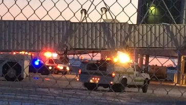 Emergency vehicles parked on a taxiway at Green Bay Austin Straubel International Airport await a jetliner Wednesday afternoon. There was another emergency landing Friday morning at the airport.