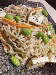 Carbohydrates don't have to be all bad. Try out this noodle dish with tofu and edamame.