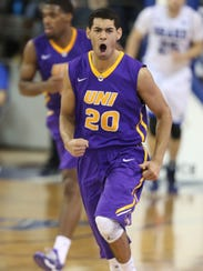 Northern Iowa's Jeremy Morgan reacts after dunking