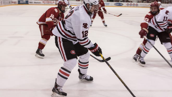 St. Cloud State defenseman Ethan Prow carries the puck Friday at the Herb Brooks National Hockey Center.