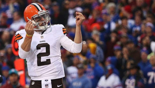 Johnny Manziel #2 of the Cleveland Browns celebrates a touchdown against the Buffalo Bills during the second half at Ralph Wilson Stadium on November 30, 2014 in Orchard Park, New York.