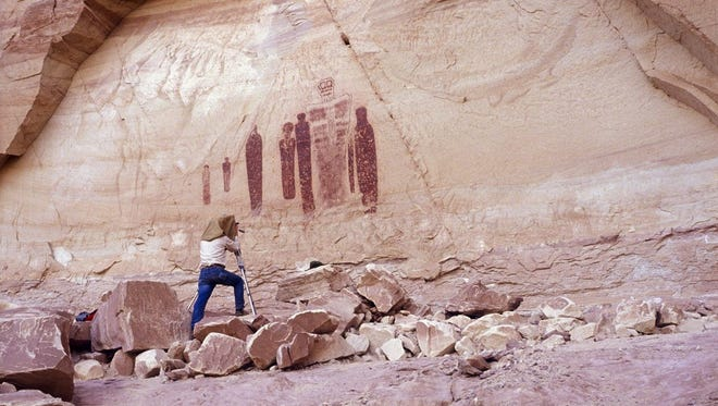 Craig Law photographs ancient rock art in a Utah canyon.