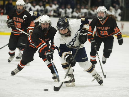 Essex's Kathleen Young (9) skates past Middlebury's