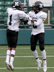 Bishop Kearney Asfa Sill (1) and Kevin Goode Jr. celebrate after a Sill touchdown in the 2016 Class C championship game.