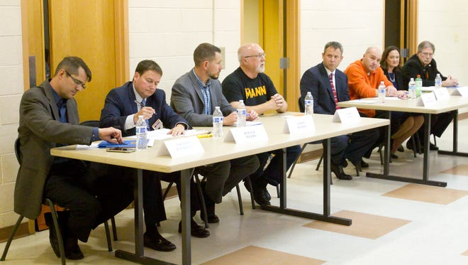 Brighton school board candidates, from left, William Rockwell, Roger Myers, Jason Tracey, Gerry Mann, Andy Burchfield, Bill Trombley, Alicia Reid and James Alexander took their turns answering eight questions posed to them by moderator Jon King of WHMI Radio in a candidates forum.
