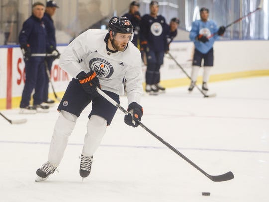 Edmonton Oilers' Leon Draisaitl (29) takes part in a drill during NHL hockey training camp in Edmonton, Alberta, Tuesday, July 14, 2020. (Jason Franson/The Canadian Press via AP)
