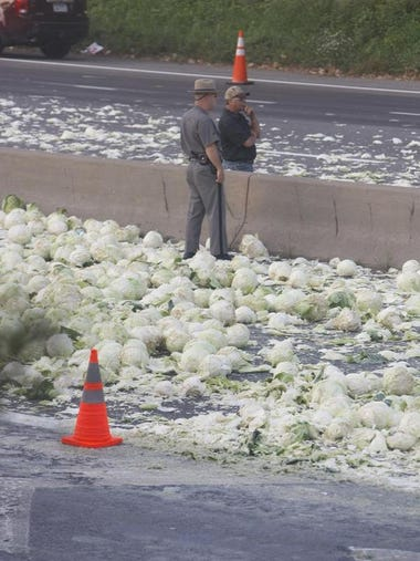 Scene from cabbage truck crash on I-490 Monday.