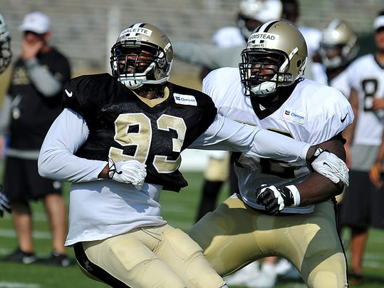 New Orleans Saints outside linebacker Junior Galette (93) and New Orleans Saints offensive tackle Terron Armstead (72) block one another during the team's NFL football training camp in White Sulphur Springs , W. Va., Monday, Aug. 4, 2014. (AP Photo/Chris Tilley)
