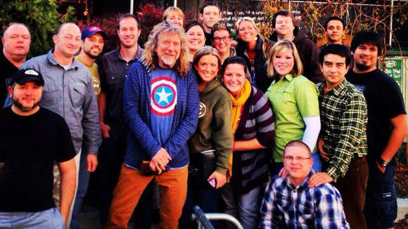 Led Zeppelin's Robert Plant poses at the Dogfish Head brewpub in 2012. He also visited the Milton brewery.