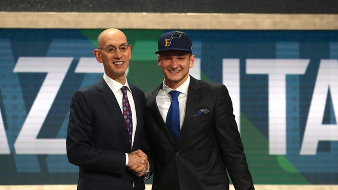 Grayson Allen poses with NBA Commissioner Adam Silver after being drafted 21st overall by the Utah Jazz during the 2018 NBA Draft at the Barclays Center on June 21, 2018 in the Brooklyn borough of New York City.