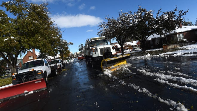 Crews clean up the roads after a storm blanketed the Reno area with snow on Nov. 10, 2015.