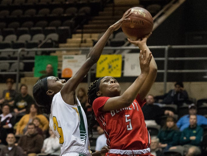 James M. Bennett's Zy'Aire Smullen (5) takes a shot
