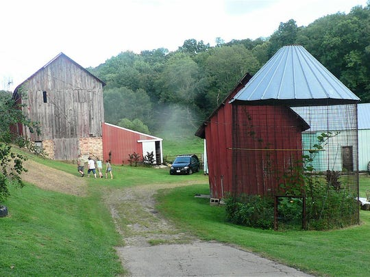 The barn and red granary (and the house) are the old buildings remaining on the farm.