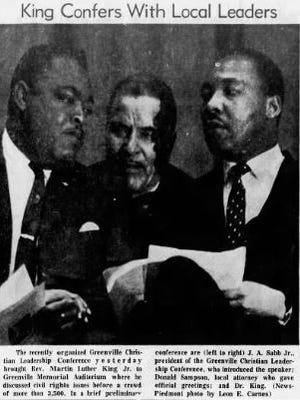 Rev. Martin Luther King Jr., far right, confers with local leaders while in Greenville.