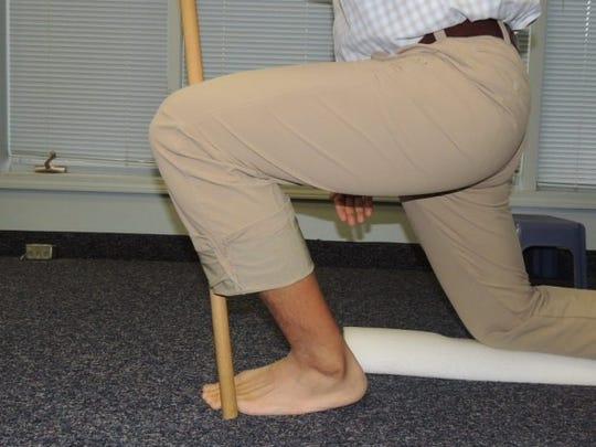 half kneel ankle mobilization (end position)