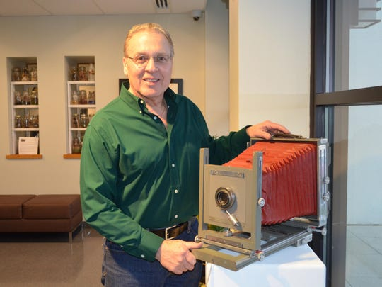 "Jack Mazzeo of Mazzeo Studio in Hammonton is pictured next to the 8x10 view camera he learned his trade on. Mazzeo contributed several photographs and his vintage cameras for display in the Noyes Gallery Exhibition, ""Hammonton: 150 Years of Industry"" at Kramer Hall, 30 Front St."