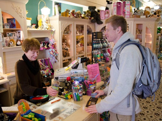 owner Bonnnie Pnazek rings up customer Troy Johnson of Stevens Point.jpg