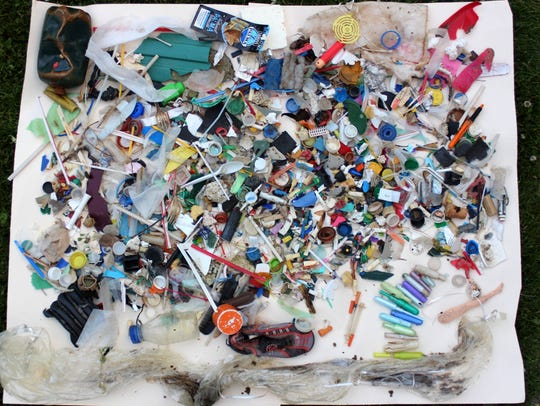Plastic trash recently found on the beach of Lake Ontario — a freshwater body — near Hamlin, New York, is shown in a USA TODAY Network photo.