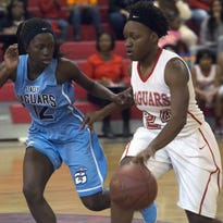 West Florida High School's Deja Jones, (No. 22) left, battles Gadsden High School's Tyliah Jones, (No. 21) right, for possession of the ball during the Region 1-4A girls' basketball semifinal game at WFHS Tuesday night.