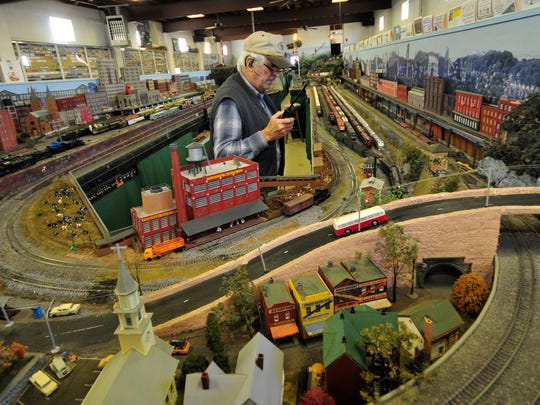 Bill Robinson, vice president of Cumberland Valley Model Railroad Club works his magic on the scale-sized rails at the Nelson Street location Wednesday, Nov. 25, 2015.