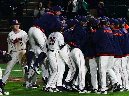 Auburn players celebrate Casey Mize's no-hitter. vs Northeastern on Friday, March 9, 2018 in Auburn, Ala.