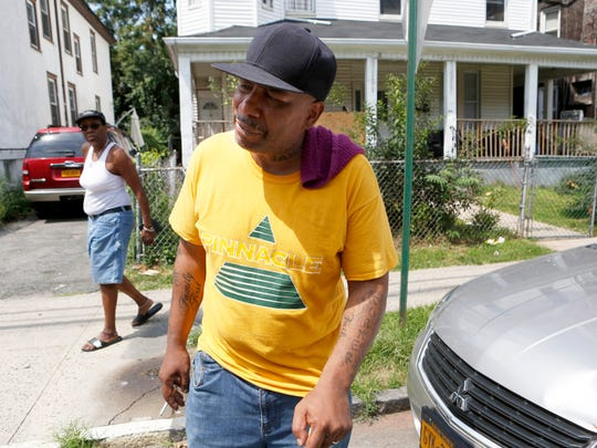 Herman Turner speaks about his wife, Raynette Turner, on Wednesday near his home in Mount Vernon. Turner, the mother of eight, died at police headquarters this week in a holding cell.