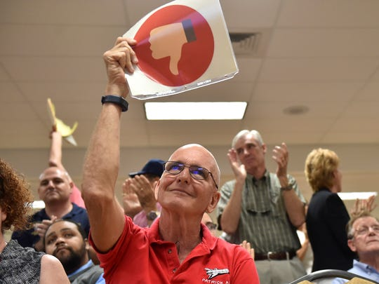 Martin Maxwell, Master Sgt. USAF Retired, of Port St. Lucie, shows his displeasure over comments from Rep. Brian Mast concerning building a wall on the U.S. southern border with Mexico, during Mast's veterans Town Hall meeting Feb. 24, 2017 at the Havert Fenn Center in Fort Pierce.