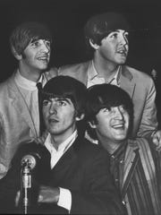 Photo from the Star-News book Hoosier Century       The Beatles--(clockwise from lower left) George Harriston Ringo Starr Paul McCartney and John Lennon--arrived in two other U.S. cities before coming to the Indiana State Fairgrounds on Sept. 3 1964 for two concerts the next day.  This photo was taken by Frank Salzarulo of The Indianapolis News at the Philadelphia stop.