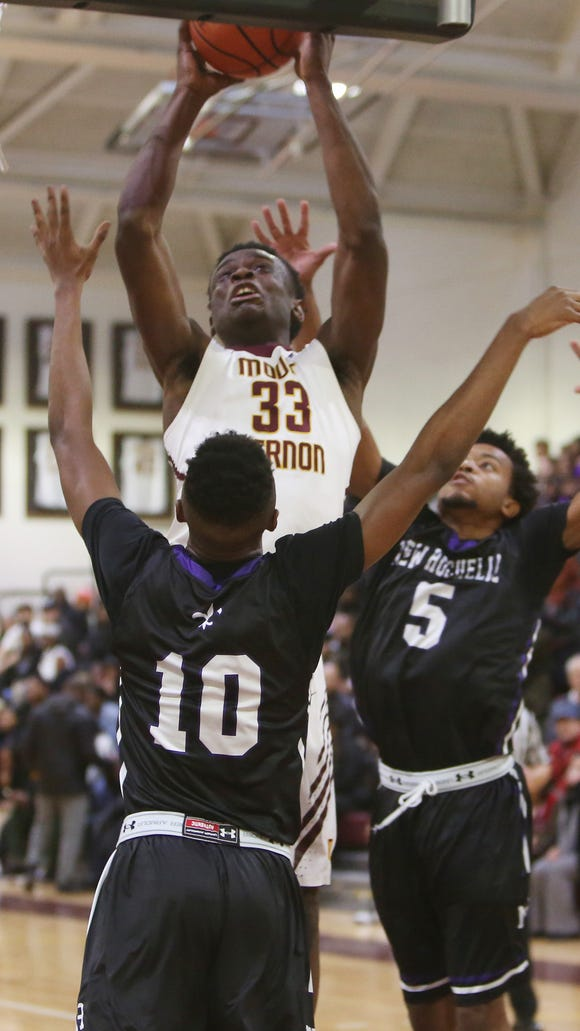 Mount Vernon's Gregory Calixte (33) goes up for a shot