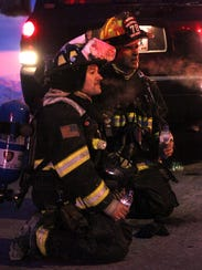 Firefighters Matt Berndt of Kronenwetter, left, and