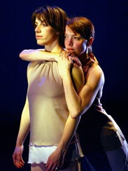 Dani Kuepper (left) and Sarah Wilbur rehearse in 2003.