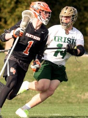 Central York's Ryan Fahs, left, is pressured by York Catholic's Harris Kohl during lacrosse action at Catholic Tuesday, April 10, 2018. Both team have qualified for the York-Adams League playoffs. Bill Kalina photo