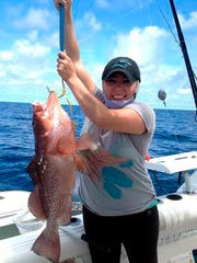 Paula Carlos' red grouper was part of a limit she caught last weekend with friends from Cape Tool & Tackle, in 100 feet of water. They sabikied live baits for their catches.