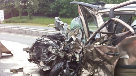 Silver SUV, which was hit head on, killing the drivers Tuesday morning on the New York State Thruway between Exit 14B and Exit 15 in Suffern Tuesday, Aug 12.
