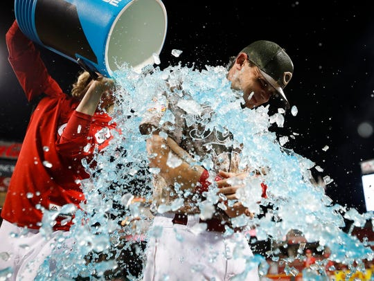 Scooter Gennett is showered with ice after hitting four home runs, including a grand slam, against the Cardinals in 2018.