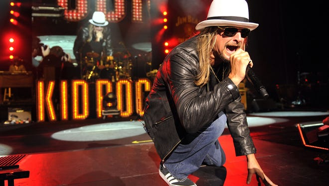 Kid Rock performs in front of a packed amphitheater during his eighth concert in 12 nights at DTE Energy Music Theatre in Clarkston. *** ZZ Top was the opening act. Photos taken on Tuesday, August 20, 2013.  ( John T. Greilick / The Detroit News )