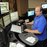 Jared Hoffman, advanced communications operator, dispatches for the county law enforcement center at Metro Communications in Sioux Falls, SD; Tuesday, Aug. 18, 2015.