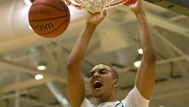Arsenal Technical High School junior Trey Lyles reacts after a slam dunk during the first half of action between Scecina Memorial High School and Arsenal Technical High School. Arsenal Technical High School hosted the quarter-final round of the 2013 Indianapolis City Boys' Basketball Tournament Thursday, Jan. 17, 2013. / Doug McSchooler/for The Star <b>01/18/2013 - C04 - MAIN - 2ND - THE INDIANAPOLIS STAR</b><br />Tech's Trey Lyles slams home two of his 18 points against Scecina. He also grabbed 11 rebounds.